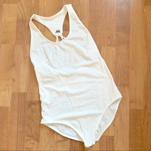 NWOT. White grommet back detail bodysuit
